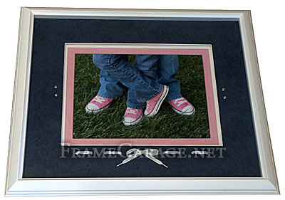 pink shoes framed with shoe laces